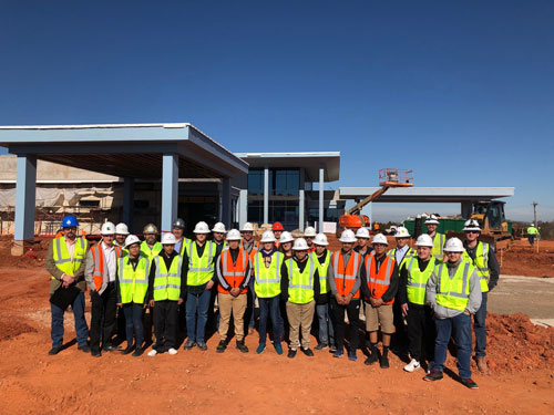 """Photo of """"Careers in Construction Day"""" participants at Manhattan Construction's McBride Ambulatory Surgical Center project site in Oklahoma City."""
