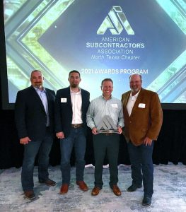 Manhattan team members accept award for Globe Life Field