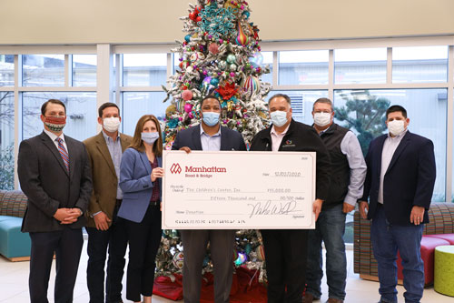MRB donates to Children's Center. Photo of Big Check