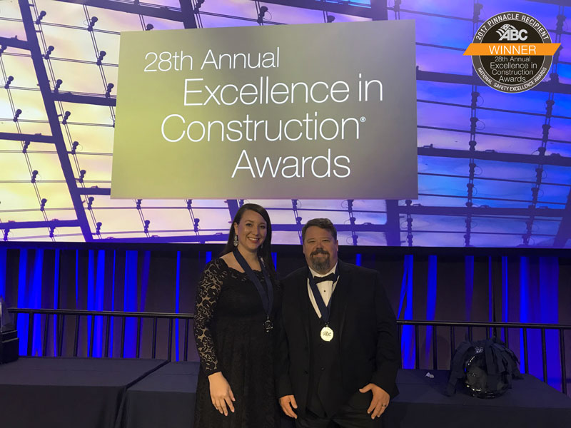 Caption: On behalf of Manhattan Construction Company, Safety Managers Trista Shomo and Scott Marsh accepted the National Safety Pinnacle Award from the Associated Builders and Contractors (ABC) on March 21 during the 28th annual Excellence in Construction® Awards at ABC Convention 2018 in Long Beach, Calif.